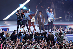 Apple Music and Capital bring together Jonas Brothers and Busted fo perform Year 3000 on stage during Capital's Summertime Ball. The world's biggest stars perform live for 80,000 Capital listeners at Wembley Stadium at the UK's biggest summer party.