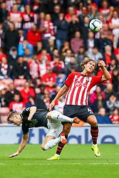 Jannik Vestergaard of Southampton wins the aerial ball after contesting with Johann Gudmundsson of Burnley  - Mandatory by-line: Ryan Hiscott/JMP - 12/08/2018 - FOOTBALL - St Mary's Stadium - Southampton, England - Southampton v Burnley - Premier League