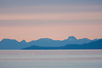 Georgia Strait and the Coast Mountain range at first light near Campbell River.  Campbell River, Vancouver Island, British Columbia, Canada.