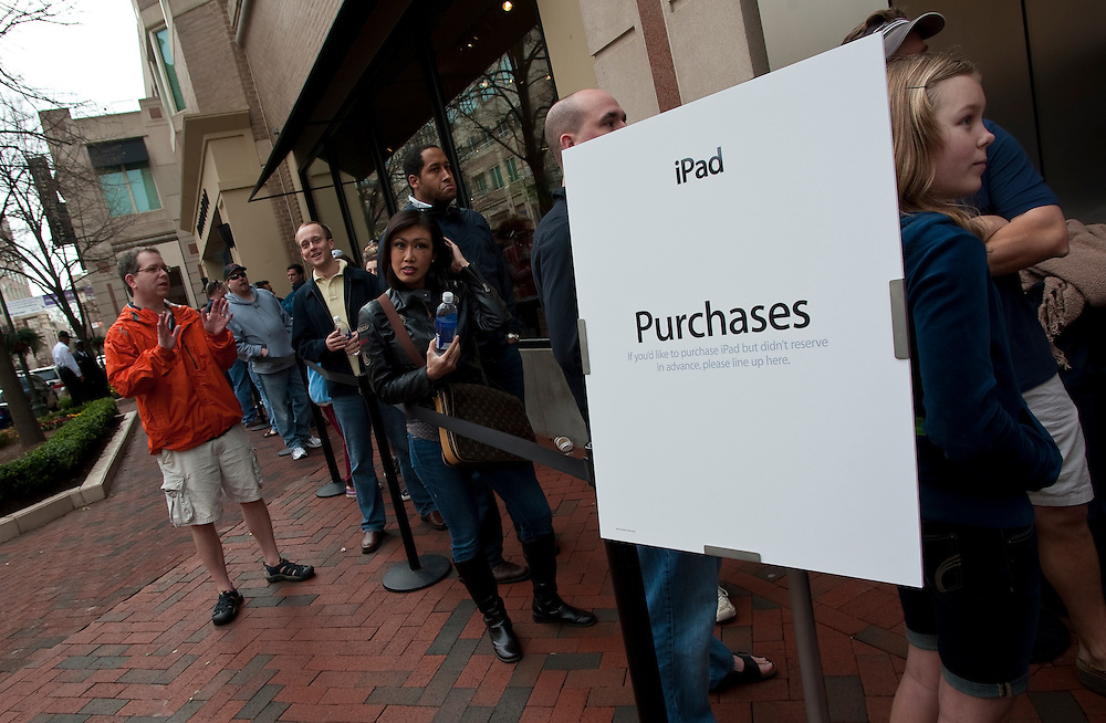 Apr 3,2010 - Reston, Virginia USA -  Customers wait in line outside of the Apple Store in Reston, VA. to be among the first to own Apple's new iPad as the new gadget goes on sale today..The iPad is a tablet computer developed by Apple Inc. It is positioned in a category between a smartphone and a laptop computer..(Credit Image: © Pete Marovich/ZUMA Press)