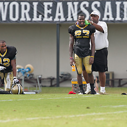 10 August 2009: New Orleans Saints rookie cornerback Malcolm Jenkins (27) cools down with the help of a trainer as safety Darren Sharper (42) kneels on the field during New Orleans Saints training camp at the team's practice facility in Metairie, Louisiana.