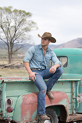 cowboy sitting on a truck