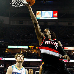 March 30, 2011; New Orleans, LA, USA; Portland Trail Blazers small forward Gerald Wallace (3) shoots over New Orleans Hornets center Aaron Gray (34) during a game at the New Orleans Arena. The Hornets defeated the Trail Blazers 95-91.   Mandatory Credit: Derick E. Hingle