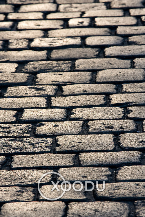 Cobblestone paved street in late afternoon (Wroclaw, Poland - Aug. 2008) (Image ID: 080806-1928481a)