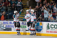 KELOWNA, CANADA - MARCH 23: Ryan Olsen #27  celebrates a goal against the Tri-City Americans with Tyrell Goulbourne #12 and Damon Severson #7 of the Kelowna Rockets on March 23, 2014 at Prospera Place in Kelowna, British Columbia, Canada.   (Photo by Marissa Baecker/Shoot the Breeze)  *** Local Caption *** Ryan Olsen; Tyrell Goulbourne; Damon Severson;