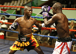 Juma Fundi of Tanzania exchange blows with Gabriel Ochieng of Kenya in the Super Feather weight category during their Mac Series Professional Boxing Bonaza at Safaricom Indoor Arena in Nairobi on November 5, 2016. Gabriel won. Photo/Fredrick Onyango/www.pic-centre.com (KEN)