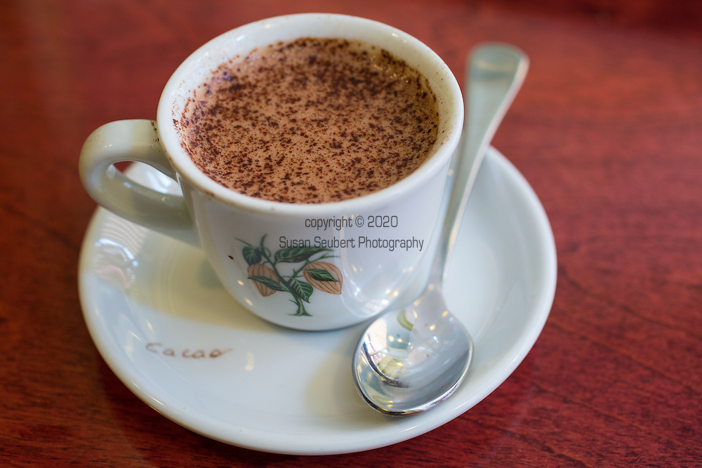 """The famous Chocolat Chaud - espresso style - at Erico's Choco-Musée, located along St. Jean Street in Quebec City's St. Jean Baptiste neighborhood, boasts not only a small museum dedicated to understanding the culture and history of chocolate, but also has some of the best Chocolat Chaud (hot chocolate) in Quebec.  Erico also makes a selection of confections and ice cream. Pictured here is the """"Espresso"""" made with 2 different kinds of dark chocolate, milk and heavy cream."""