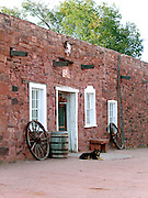 A dog relaxes in the late afternoon at the entrance to the Hubbell Trading Post in Ganado, Arizona USA - October 23, 2006.  The trading post, now a National Historic Site, is located on the Navajo Reservation in northeastern Arizona.