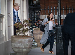 © Licensed to London News Pictures. 05/10/2017. London, UK. Foreign Secretary Boris Johnson leaves home with his wife Marina the day after the Conservative Party conference ended. Prime Minister Theresa May's leadership has been called into question after a disastrous keynote speech on the final day of conference.   Photo credit: Peter Macdiarmid/LNP