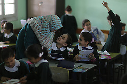 A teacher talks to students in a class at an al-Qahera elementary mixed school in Gaza City, on April 2, 2013. New rules from the Education Ministry of the Islamist Hamas movement would bar men from teaching at girls schools and mandate separate classes for boys and girls from the age of nine. , on April 2, 2013. Photo by Imago / i-Images...UK ONLY..