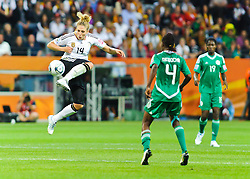 30.06.2011, Commerzbank-Arena, Frankfurt, GER, FIFA Women Worldcup 2011, GRUPPE A, Deutschland (GER) vs. Nigeria (NGR) , im Bild Kim Kulig (Deutschland #14, Hamburg) passt den Ball in der Luftkampf mit der Hacke // during the FIFA Women Worldcup 2011, Pool A, Germany vs. Nigeria on 2011/06/30, Commerzbank-Arena, Frankfurt, Germany. EXPA Pictures © 2011, PhotoCredit: EXPA/ nph/  Roth       ****** out of GER / CRO  / BEL ******