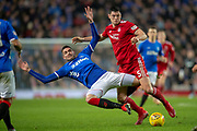 Kyle Lafferty (#38) of Rangers FC is fouled by Scott McKenna (#5) of Aberdeen FC during the Ladbrokes Scottish Premiership match between Rangers and Aberdeen at Ibrox, Glasgow, Scotland on 5 December 2018.
