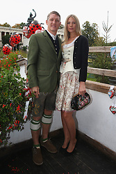 06.10.2013, Kaefers Wiesenschaenke, Muenchen, GER, der FC Bayern Muenchen beim Oktoberfest, im Bild Bastian Schweinsteiger of Bayern Muenchen poses with Sarah Brandner in front of the ensemble of the Bavaria statue, a monumental bronze sand-cast 19th-century statue and the Hall of Fame (Ruhmeshalle). The Bavaria is the female personification of the Bavarian homeland and by extension its strength and glory // during the Oktoberfest 2013 beer festival at Kaefers Wiesenschaenke in Munich, Germany on 2013/10/06. EXPA Pictures © 2013, PhotoCredit: EXPA/ Eibner/ Eckhard Eibner<br /> <br /> ***** ATTENTION - OUT OF GER *****