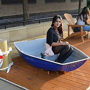Asian girls having fun at the boat exhibition at The Queen walk street Photography, on 28 June 2019, London, UK.