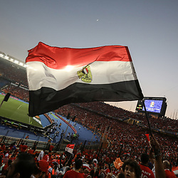 06 July 2019, Egypt, Cairo: Egypt supporters wave the nationl flag as they cheer in the stands prior to the start of the 2019 Africa Cup of Nations round of 16 soccer match between Egypt and South Africa at Cairo International Stadium. Photo : PictureAlliance / Icon Sport