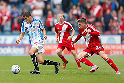 Conor Coady of Huddersfield is challenged by Adam Reach of Middlesbrough - Photo mandatory by-line: Rogan Thomson/JMP - 07966 386802 - 13/09/2014 - SPORT - FOOTBALL - Huddersfield, England - The John Smith's Stadium - Huddersfield town v Middlesbrough - Sky Bet Championship.