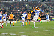 Hull City defender Curtis Davies (6) heads towards goal blocked by Michael Turner of Sheffield Wednesday  during the Sky Bet Championship match between Hull City and Sheffield Wednesday at the KC Stadium, Kingston upon Hull, England on 26 February 2016. Photo by Ian Lyall.