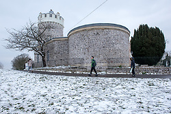 © Licensed to London News Pictures. 18/03/2018. Bristol, UK. The Bristol Observatory by the Clifton Suspension Bridge with snow, during a cold weather dubbed the 'mini beast from the east', the second spell of snow and freezing weather to hit the UK in March. Photo credit: Simon Chapman/LNP