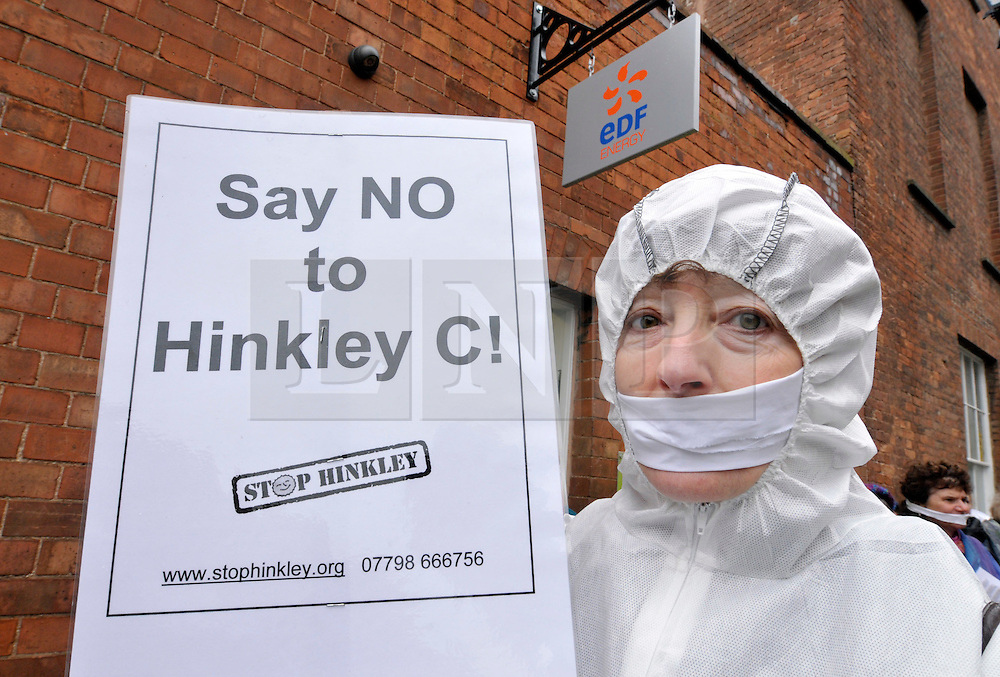 """© Licensed to London News Pictures. 28/07/2016. Bridgwater, Somerset, UK.  A final investment decision is expected today from French energy company EDF to go ahead with the building of Hinkley C nuclear power plant, the first nuclear power plant to be built in the UK for 20 years, which will be built next to the existing Hinkley A and B nuclear plants near Bridgwater. FILE PICTURE dated 15 January 2010; Protest at the offices of EDF energy in Kings Square, Bridgwater, Somerset. The protest is against the proposals by EDF to build a new nuclear power station, Hinkley C, at nearby Hinkley Point where there is already an existing nuclear power station. Anti-nuclear campaigners are angry that the final decision about this major project – the largest nuclear plant ever proposed in the UK – will be made by a new Government quango, the Infrastructure Planning Commission. They say the IPC is an unelected body whose members have been appointed by the government to implement its energy policy. This policy is in favour of """"new nuclear build"""".  When the last Hinkley C proposal was made in the late 1980s there was a public inquiry, and the project did not go ahead. Photo credit : Simon Chapman/LNP"""