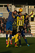 George Porter & George Francomb tussle during the Sky Bet League 2 match between AFC Wimbledon and Dagenham and Redbridge at the Cherry Red Records Stadium, Kingston, England on 15 November 2014.
