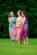 Old Westbury, New York, U.S. 22nd June 2013. Dancers in Lori Belilove &amp; The Isadora Duncan Dance Company, perform a dance of the Three Graces, at the Midsummer Night event at Old Westbury Gardens, throughout the illuminated grounds of the historic Long Island Gold Coast estate.<br /> The Three Graces, or Three Charities, of Greek mythology were Aglaia, Euphrosyne, and Thalia - goddesses of beauty, joy, harmony, pleasure, grace, festivity, adornment, dance, and song. Daughters of Zeus and sea-nymph Eurynome, they were also the attendants, or handmaidens, of Aphrodite and Hera and protectors of vegetation.