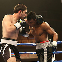 "Simeon Hardy (right) fights against Rahman Yusubov during the undercard bout of the ESPN ""Boxcino"" boxing tournament at Turning Stone Resort Casino on Friday, April 18, 2014 in Verona, New York.  (AP Photo/Alex Menendez)"