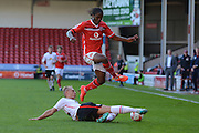 Crewe Alexandra defender George Ray tackles Walsall midfielder Romaine Sawyers during the Sky Bet League 1 match between Walsall and Crewe Alexandra at the Banks's Stadium, Walsall, England on 26 September 2015. Photo by Alan Franklin.