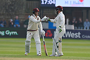 Tom Abell of Somerset touches gloves with Steve Davies of Somerset as they build a partnership during the Specsavers County Champ Div 1 match between Somerset County Cricket Club and Kent County Cricket Club at the Cooper Associates County Ground, Taunton, United Kingdom on 7 April 2019.