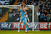Notts County defender Shaun Brisley (16) challenges Coventry City defender Chris Stokes (3)  during the EFL Sky Bet League 2 match between Notts County and Coventry City at Meadow Lane, Nottingham, England on 18 May 2018. Picture by Simon Davies.