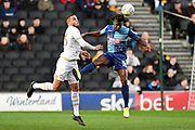 Wycombe Wanderers defender Anthony Stewart (5) `heads under pressure from Milton Keynes Dons forward (on loan from Norwich) Carlton Morris (23) during the EFL Sky Bet League 1 match between Milton Keynes Dons and Wycombe Wanderers at stadium:mk, Milton Keynes, England on 1 February 2020.