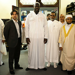 London, UK - 21 July 2012: Team GB Olympic discus thrower Abdul Buhari poses for a picture with Sheikh Khalifa Ezzat, Head Imam of the London Central Mosque in Regents Park during the Ramadan Iftar 2012 celebrations