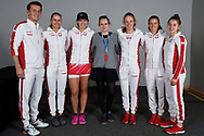Zielona Gora, Poland - 2019 February 09: Tennis players members Polish national team (L-R) captain Dawid Celt and Magda Linette and Iga Swiatek and Magdalena Frech and Alicja Rosolska and Maja Chwalinska all from Poland and journalist (C) Justyna Kostyra pose to the picture during 2019 Fed Cup Europe / Africa Group I Tournament at MOSiR Hall on February 09, 2019 in Zielona Gora, Poland.<br /> <br /> Mandatory credit:<br /> Photo by © Adam Nurkiewicz<br /> <br /> Picture also available in RAW (NEF) or TIFF format on special request.<br /> <br /> Any editorial, commercial or promotional use requires written permission.<br /> <br /> Adam Nurkiewicz declares that he has no rights to the image of people at the photographs of his authorship.<br /> <br /> Image can be used in the press or another use when the method of use and the signature does not hurt people on the picture.