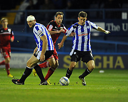 Bristol City's Sam Baldock takes the ball past Sheffield Wednesday's Martin Taylor and Sheffield Wednesday's Lewis Buxton - Photo mandatory by-line: Joe Meredith/JMP  - Tel: Mobile:07966 386802 08/12/2012 - Sheffield Wednesday v Bristol city - SPORT - FOOTBALL - Championship -  Sheffield - Hillsborough -