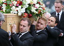 © Licensed to London News Pictures . 18/03/2016 . Manchester , UK . L to R Alan Halsall, Mikey North and Ryan Thomas carrying the coffin, followed by Antony Cotton carrying Tony Warren's mbe. Television stars and members of the public attend the funeral of Coronation Street creator Tony Warren at Manchester Cathedral . Photo credit : Joel Goodman/LNP