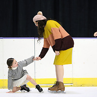 Rymi Porterfield, 6, gets right back up off the ice with the help of her mom Amelia, Saturday at the Bancorpsouth Arena