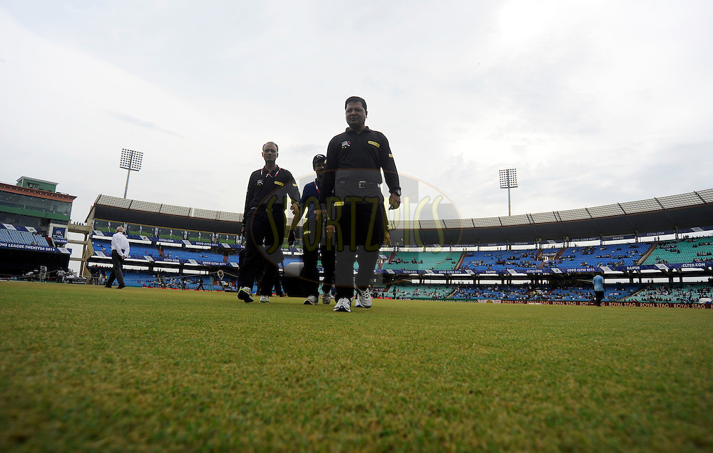 Field umpires take a closer look at the ground as wet ground delays the start of the qualifier 1 match of the Oppo Champions League Twenty20 between the Northern Knights and the Southern Express held at the Chhattisgarh International Cricket Stadium, Raipur, India on the 13th September 2014<br /> <br /> Photo by:  Pal Pillai / Sportzpics/ CLT20<br /> <br /> <br /> Image use is subject to the terms and conditions as laid out by the BCCI/ CLT20.  The terms and conditions can be downloaded here:<br /> <br /> http://sportzpics.photoshelter.com/gallery/CLT20-Image-Terms-and-Conditions-2014/G0000IfNJn535VPU/C0000QhhKadWcjYs