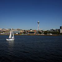 A boat sails past the shore line, including the space needle in Seattle, Washington.Melanie Maxwell