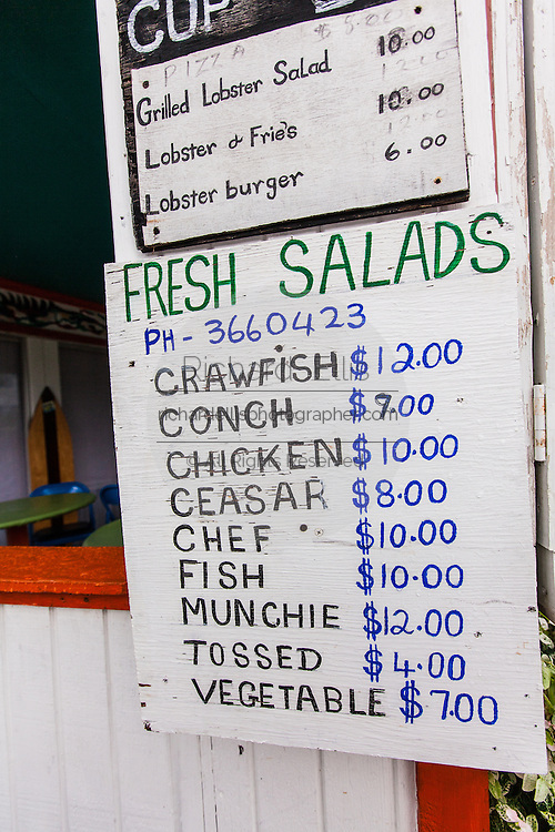 Sign board advertising the menu at Munchies in the tiny village of Hope Town, Elbow Cay Abacos, Bahamas.