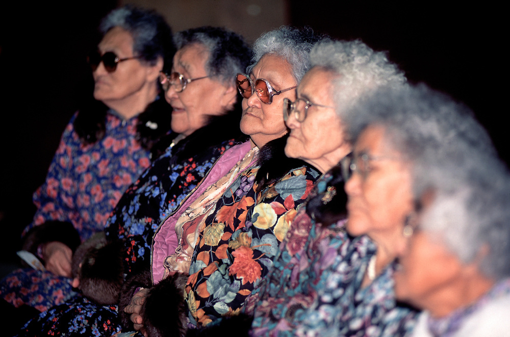Barrow, Alaska, Row of elderly native alaskans  wearing traditional fur trimmed kuspuks