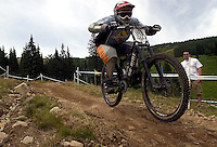 JEROME A. POLLOS/Press..Brenden Delewese catches some of the action during the downhill mountain biking practice runs.