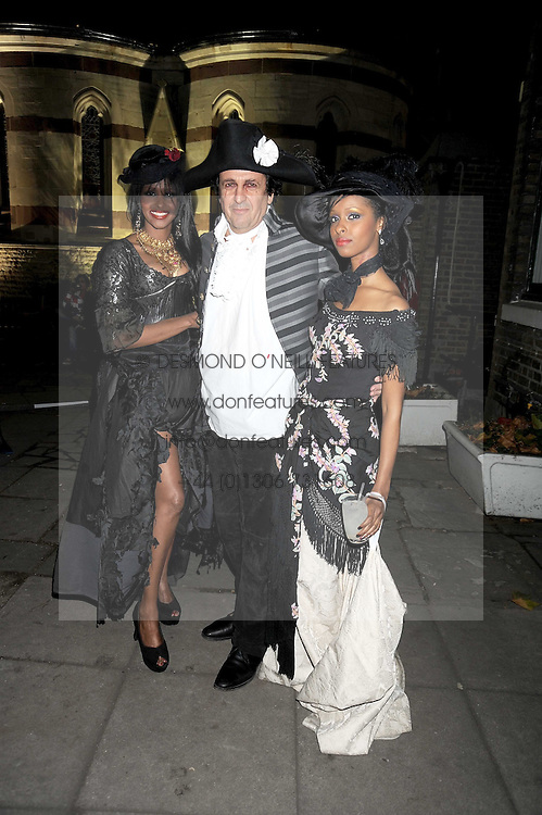 Left to right, AYAN HUSSEIN, SIMON BURSTEIN CEO of Browns and SAGAL MOHAMED at a Halloween party hosted by Alexa Chung and Browns Focus held at the House of St.Barnabas, 1 Greek Street, London on 31st October 2008.