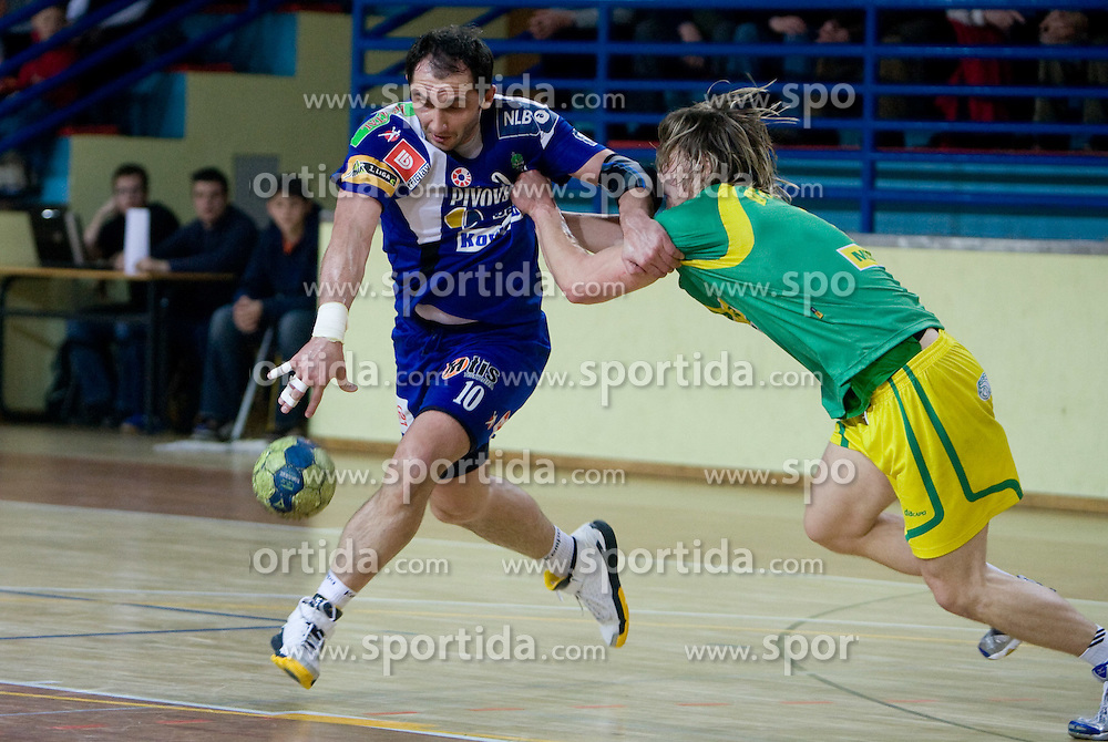 Alem Toskic of Celje vs Jure Dolenec  of Merkur  at 1st MIK Handball League match between RD Merkur Skofja Loka and RK Celje Pivovarna Lasko, on February 6, 2010 in Arena Poden, Skofja Loka, Slovenia. The teams drew a tie 28:28. (Photo by Vid Ponikvar / Sportida)