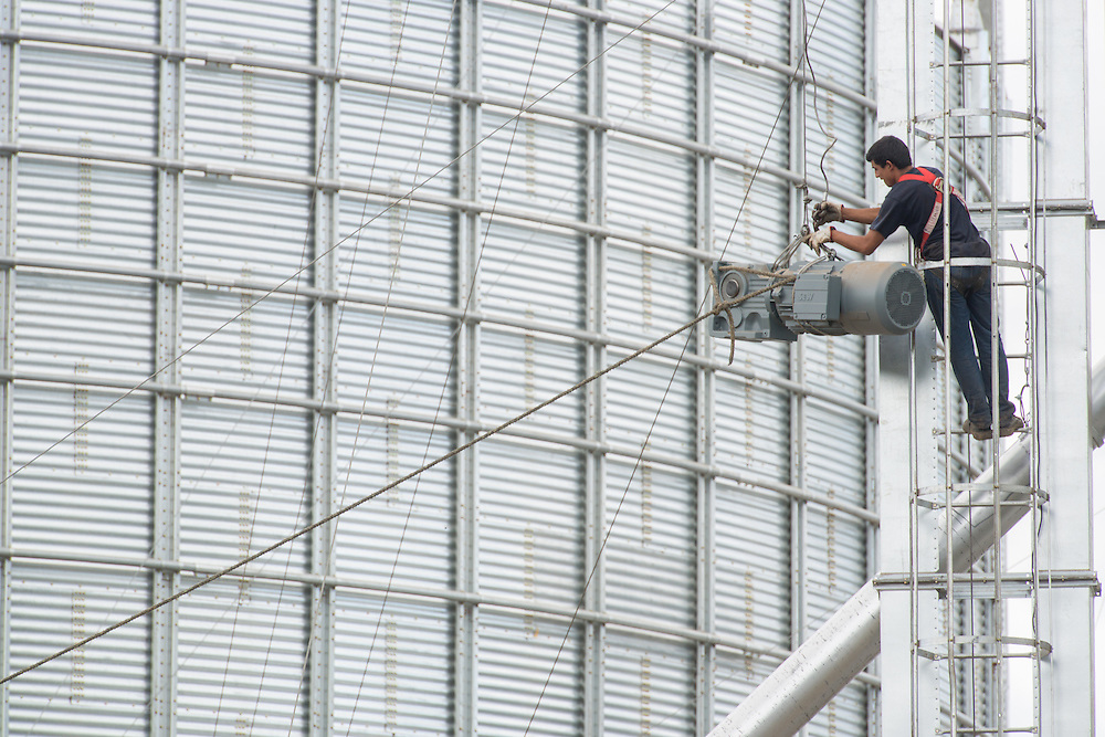 Workers at Fixing Silo Wire