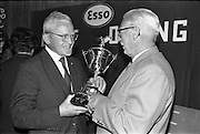 23/05/1963<br /> 05/23/1963<br /> 23 May 1963<br /> Esso Staff Golf Outing at Woodbrook Golf Club, Co. Dublin. Picture shows Mr. J.E. Pennyfeather (right) Ex-Secretary and Controller, Esso, who won the 1st Esso Cup and Captain's Prize in 1931 congratulating the day's winner Mr. T. Whelan of Cork.