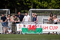 """NEWTOWN, WALES - Sunday, May 6, 2018: Supporters with a flag """"Immerse Me In Your Splendour"""" look on during the FAW Welsh Cup Final between Aberystwyth Town and Connahs Quay Nomads at Latham Park. (Pic by Paul Greenwood/Propaganda)"""