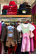 Traditional Tyrolean dirndl dress and lederhosen outfit in shop window  in Hofgasse in Innsbruck, the Tyrol, Austria
