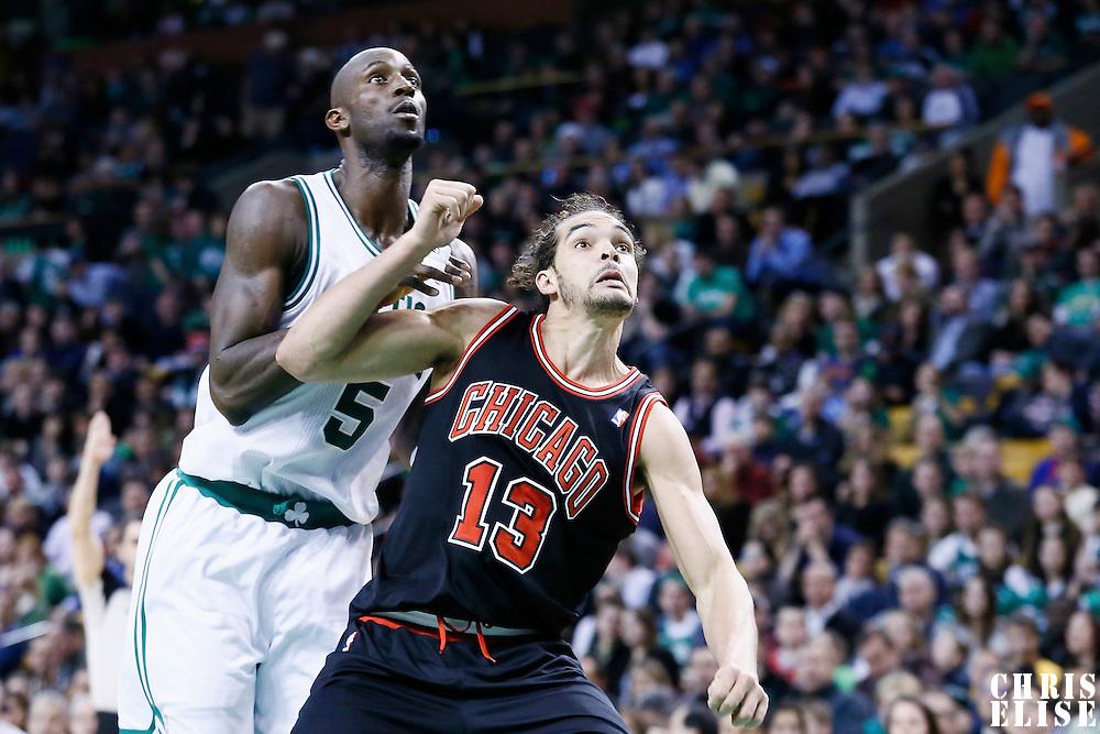 18 January 2013: Chicago Bulls center Joakim Noah (13) vies for the rebound with Boston Celtics power forward Kevin Garnett (5) during the Chicago Bulls 100-99 overtime victory over the Boston Celtics at the TD Garden, Boston, Massachusetts, USA.