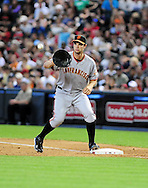 Apr. 17 2011; Phoenix, AZ, USA; San Francisco Giants first basemen .Mark DeRosa (7) catches the ball for a force out against the Arizona Diamondbacks at Chase Field. The Diamondbacks defeated the Giants 6-5 in extra innings. Mandatory Credit: Jennifer Stewart-US PRESSWIRE..