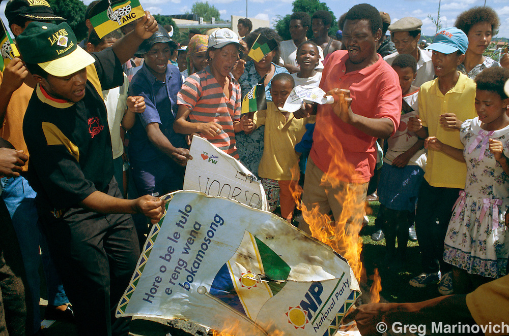 ANC supporters burn National Party posters when President FW de Klerk came to a pre election rally 1994. South Africa
