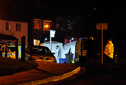 © Licensed to London News Pictures. 27/01/2013. Bristol, UK. Police tents cover the scene where two cyclists, a man and a woman, died after they were involved in a hit and run accident with a vehicle in Lower Hanham Road, Hanham, Bristol.  27 January 2013..Photo credit : Simon Chapman/LNP